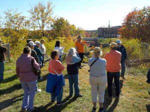 Colorful Walktober offers history in The Last Green Valley; in this case the topic was the river, rails, and mills of Putnam, CT. Photo by K. Carpenter.
