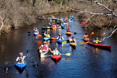 Paddlers waving-from Source to sea cd1